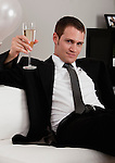 Young elegant man toasting with champagne