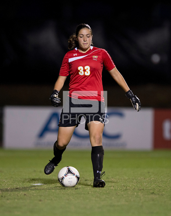 Rachelle Beanlands (33) of Maryland passes the ball out of the box during the game in College Park, MD.  Maryland defeated Virginia, 3-1.