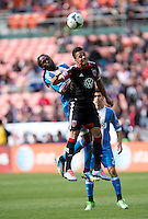 Marcelo Saragosa (11) of D.C. United goes up for a header with Keon Daniel (26) of the Philadelphia Union during the game at the RFK Stadium in Washington DC.  Philadelphia defeated D.C. United, 3-2.