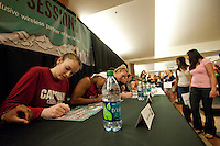 DENVER, CO--Bonnie Samuelson signs posters during a fan autograph session at the Pepsi Center for the 2012 NCAA Women's Final Four festivities in Denver, CO.