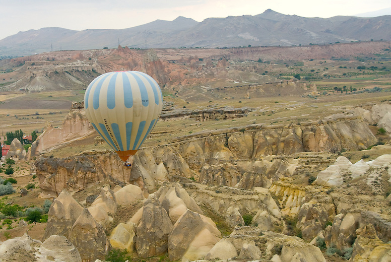 Balloon ride over Cappadocia. The region's soil is extremely fertile, and was the breadbasket for the Byzantine Empire. Today Cappadocia is known for its wine, and vineyards are sprinkled throughout the rock formations.