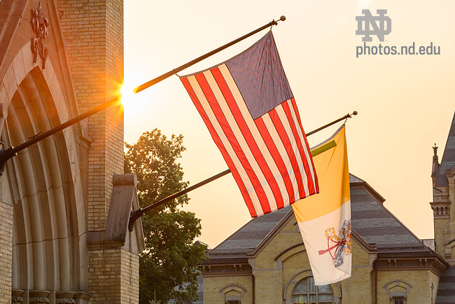 July 20, 2021; U.S. and Papal flags over the main door to the Basilica of the Sacred Heart (Photo by Matt Cashore/University of Notre Dame)