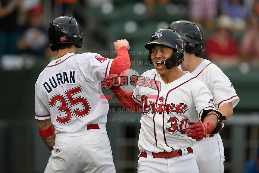 Third baseman Tanner Nishioka (30) of the Greenville Drive is congratulated by Jarren Duran (35) after hitting a three-run home run during a game against the Lexington Legends on Sunday, September 2, 2018, at Fluor Field at the West End in Greenville, South Carolina. Greenville won, 7-4. (Tom Priddy/Four Seam Images)