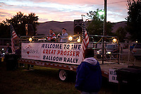 Organizers of the Great Prosser Balloon Rally address the audience and pilots before dawn in Prosser, Washington, USA.