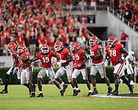ATHENS, GA - SEPTEMBER 18: Members of the Georgia defense celebrate recovery of a fumble before a game between South Carolina Gamecocks and Georgia Bulldogs at Sanford Stadium on September 18, 2021 in Athens, Georgia.