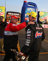 Feb 9, 2014; Pomona, CA, USA; NHRA pro stock runner up V. Gaines (left) congratulates NHRA pro stock driver Jason Line after winning the Winternationals at Auto Club Raceway at Pomona. Mandatory Credit: Mark J. Rebilas-