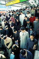 Crowd at the railway station during peak hour in Tokyo.