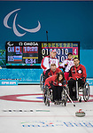Sochi, RUSSIA - Mar 8 2014 -  Ina Forrest takes a shot as Dennis Thiessen and Mark Ideson look on as Canada takes on Russia in Wheelchair Curling during the 2014 Paralympic Winter Games in Sochi, Russia.  (Photo: Matthew Murnaghan/Canadian Paralympic Committee)