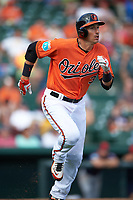 Baltimore Orioles third baseman Ryan Flaherty (3) runs to first base during a Spring Training game against the Minnesota Twins on March 7, 2016 at Ed Smith Stadium in Sarasota, Florida.  Minnesota defeated Baltimore 3-0.  (Mike Janes/Four Seam Images)