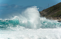 A large wave explodes on the reef at Ka'ena Point State Park on O'ahu.