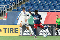 FOXBOROUGH, MA - AUGUST 7: Meny Silva #36 of New England Revolution II passes the ball as Juan Pablo Monticelli #55 of Orlando City B defends during a game between Orlando City B and New England Revolution II at Gillette Stadium on August 7, 2020 in Foxborough, Massachusetts.