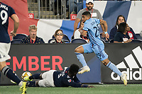 FOXBOROUGH, MA - SEPTEMBER 29: Jalil Anibaba #3 of New England Revolution slide tackles Ismael Tajouri-Shradi #29 of New York City FC during a game between New York City FC and New England Revolution at Gillettes Stadium on September 29, 2019 in Foxborough, Massachusetts.