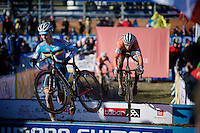 Laurens Sweeck (BEL) runs over the barriers while Stan Godrie (NLD) bunnyhops them<br /> <br /> Men U23 race<br /> <br /> 2015 UCI World Championships Cyclocross <br /> Tabor, Czech Republic