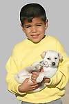 BOY WITH WHITE PUPPY