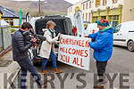 Helen Richmond and Andrew Scattergood bring signs to the Skelig Star Hotel in Cahersiveen on Wednesday ahead of the refugees arrival.