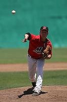 Tyler Burgoon #24 of the High Desert Mavericks pitches against the Visalia Rawhide at Stater Bros. Stadium on May 16, 2012 in Adelanto,California. (Larry Goren/Four Seam Images)