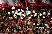 BOGOTA - COLOMBIA – 23 – 05 - 2017: Hinchas de Independiente Santa Fe, animan a su equipo durante partido entre Independiente Santa Fe de Colombia y The Strongest de Bolivia, de la fase de grupos, grupo 2, fecha 6 por la Copa Conmebol Libertadores Bridgestone 2017, en el estadio Nemesio Camacho El Campin, de la ciudad de Bogota. / Fans of Independiente Santa Fe, cheer for their team during a match between Independiente Santa Fe of Colombia and The Strongest of Bolivia, of the group stage, group 2 of the date 6th, for the Conmebol Copa Libertadores Bridgestone 2017 at the Nemesio Camacho El Campin in Bogota city. VizzorImage / Luis Ramirez / Staff.