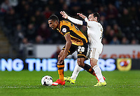 Isaac Hayden of Hull City and Leon Britton of Swansea City during the Capital One Cup match between Hull City and Swansea City played at the Kingston Communications Stadium, Hull