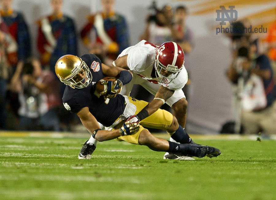 Jan. 7, 2013; Wide receiver TJ Jones makes a catch for a gain of 9 yards as Alabama defensive back Deion Belue defends during the first half of  the 2013 BCS National Championship in Miami, Florida. Alabama defeated Notre Dame 42 to 14. Photo by Barbara Johnston/University of Notre Dame