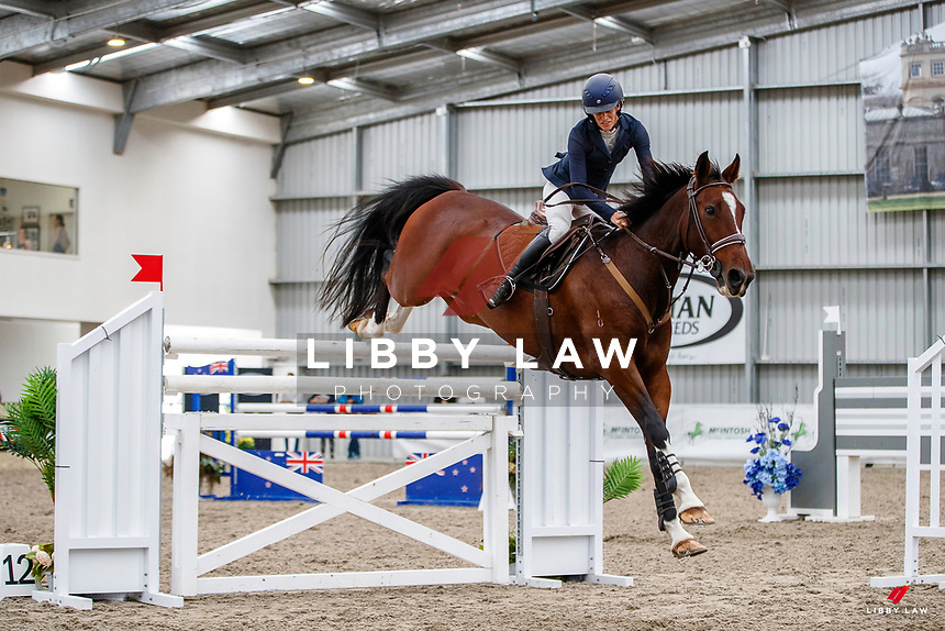 NZL-Emma Gaze rides Kowhai Bug. Class 29: Fiber Fresh Horse 1.40m-1.45m 10K - FINAL. 2021 NZL-Easter Jumping Festival presented by McIntosh Global Equestrian and Equestrian Entries. NEC Taupo. Sunday 4 April. Copyright Photo: Libby Law Photography