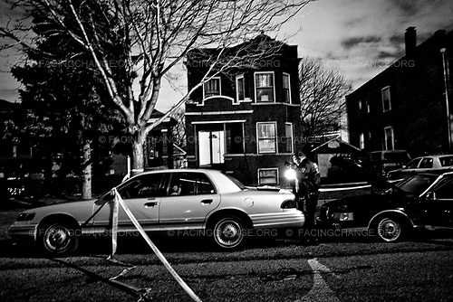 Chicago Illinois USA<br /> July 2008<br /> <br /> A Chicago police evidence technician takes a picture of a car that was shot out in a gang related shooting.