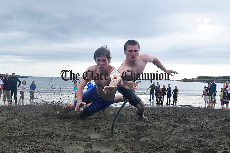 Oisin Guilfoyle (right) from Ennis competing against Jason Mc Menamin from Donegal at the National Trials for the Junior Surfing National Team which took place at Whitestrand on Thursday. Photograph by Declan Monaghan
