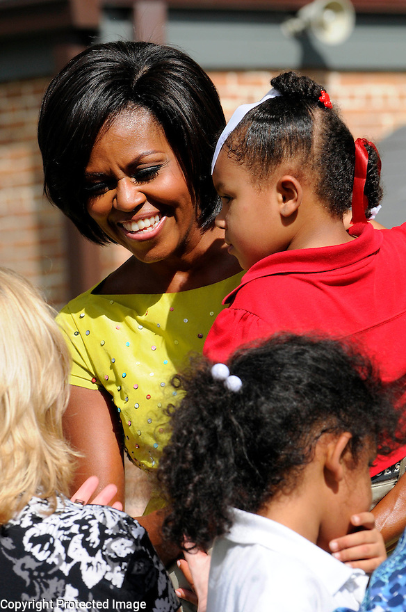 "First Lady Michelle Obama speaks to children and school officials as part of her ""Let's Move"" campaign to fight childhood obesity at Brock Elementary School in Slidell, La., September 8, 2010.....REUTERS/Cheryl Gerber (UNITED STATES)."
