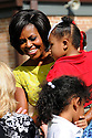 """First Lady Michelle Obama speaks to children and school officials as part of her """"Let's Move"""" campaign to fight childhood obesity at Brock Elementary School in Slidell, La., September 8, 2010.....REUTERS/Cheryl Gerber (UNITED STATES)."""