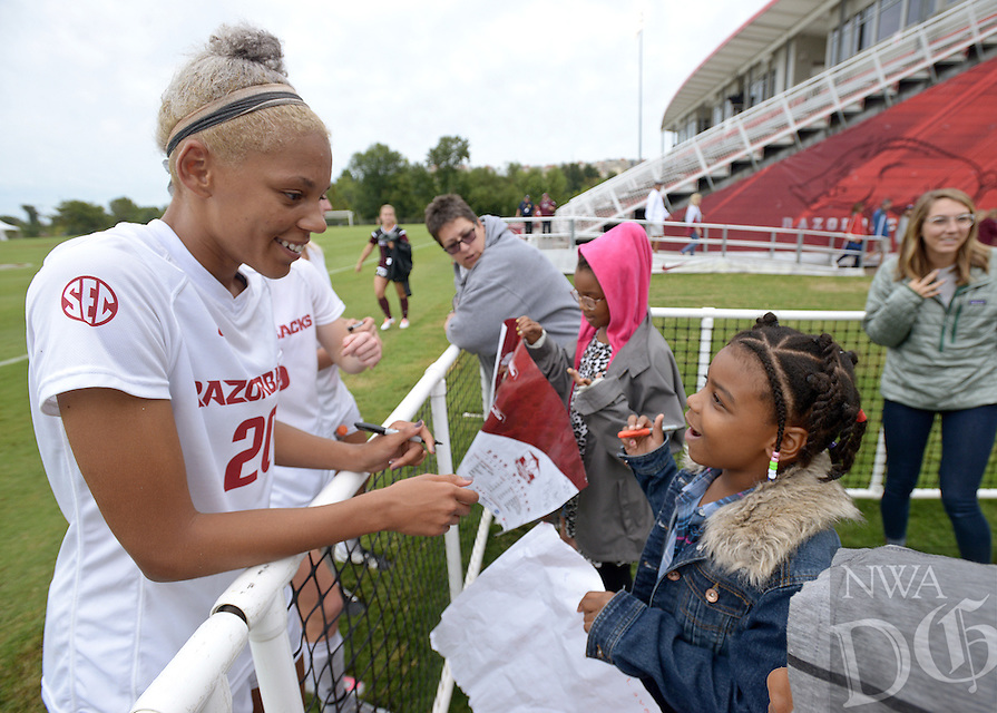 NWA Democrat-Gazette/BEN GOFF @NWABENGOFF<br /> Dee Dee Green of the Arkansas women's soccer team autographs a poster for Amber Williams, 7, of Bentonville on Sunday Sept. 20, 2015 after the Razorbacks' loss to Mississippi State in Fayetteville.