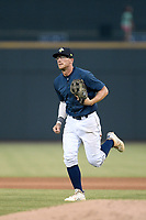 Second baseman Chandler Avant (5) of the Columbia Fireflies runs off the field in a game against the Rome Braves on Tuesday, June 4, 2019, at Segra Park in Columbia, South Carolina. Columbia won, 3-2. (Tom Priddy/Four Seam Images)