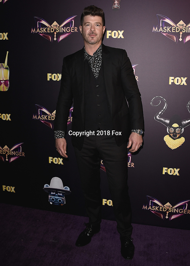 """WEST HOLLYWOOD - DECEMBER 13:  Robin Thicke at the premiere karaoke event for season one of """"The Masked Singer"""" at The Peppermint Club on December 13, 2018 in West Hollywood, California. (Photo by Scott Kirkland/Fox/PictureGroup)"""