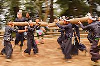 Asia,Cina,Guizhou,Basha,Miao ethnic minority group playing fight with bamboo ,China minority