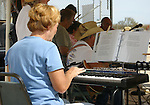 Woman entertains to an open air audience