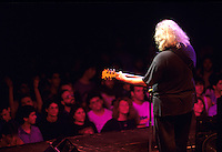 """Jerry Garcia of The Grateful Dead performs during a concert in Oakland.    Deadheads from around the country gathered for an annual pilgrimage to attend a series of concerts over New Years.   The remaining members of the band will reunite for the final time for the """"Fare Thee Well"""" concerts  over July 4th weekend in 2015."""