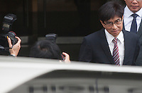 Thomas Chan Kui-yuen, executive director of Sun Hung Kei Properties, is seen leaving at the High Court of Hong Kong on day one of Hong Kong's most high profile corruption case in history, Hong Kong, China, 08 May 2014. The two property tycoon Kwok brothers Thomas and Raymond Kwok, as well as Rafael Hui who was once Hong Kong's second most senior official, are being charged with misconduct in public office relating to a high profile bribery scandal.