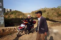 CHINA. Local residents in Zijun village in Kunming, home of the Samatao minority. 2010