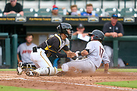 Bradenton Marauders catcher Endy Rodriguez (5) tags Cameron Barstad (17) out at home during a game against the Jupiter Hammerheads on June 23, 2021 at LECOM Park in Bradenton, Florida.  (Mike Janes/Four Seam Images)