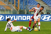 Roma's Lorenzo Pellegrini, center, fight for the ball against Genoa's Francesco Cassata, left, and Milan Badelj, during the Italian Serie A Football match between Roma and Genoa at Rome's Olympic stadium, March 7, 2021.<br /> UPDATE IMAGES PRESS/Riccardo De Luca