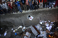 A photograph of King Gyanendra falls into a ditch strewn with other items tossed in by rioters in Kathmandu, Nepal on 21 April, 2006. Tens of thousands of pro-democracy protesters defied curfew orders and a ban on political demonstrations to rally against King Gyanendra's absolute rule.<br />
