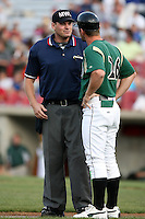 August 15 2008:  Home plate umpire Brandon Misun listens to an argument by Kane County Cougars manager Aaron Nieckula (26) during a game at Philip B. Elfstrom Stadium in Geneva, IL.  Photo by:  Mike Janes/Four Seam Images