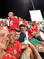 COPY BY TOM BEDFORD MEDIA<br /> Pictured: Matt Evans (L) in Cyprus watching Wales on the Euro 2016 trail in September 2015.<br /> Re: Former postman, lotto Millionaire Matt Evans, 35, from Barry, south Wales, who has been spending his winnings to travel the world to watch various sports events.