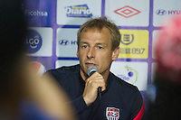 United States Men's National Coach Jurgen Klinsmann addresses the media before the team's practice at Estadio Mateo Flores in Guatemala City, Guatemala on Mon. June 11, 2012.