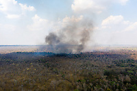 Aerial view of fires burning in the Phnom Tnout Phnom Pok Wildlife Sanctuary, in Songkom Thmey District, Preah Vihear Province, northern Cambodia.