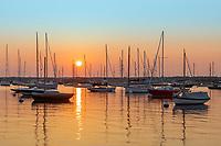 A sunrise view of sailboats and pleasure craft moored in Vineyard Haven Harbor in Tisbury, Massachusetts on Martha's Vineyard.