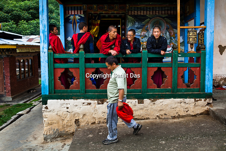 Monks share a light moment during their break at the Ramtanka Temple in Paro, Bhutan. Photo: Sanjit Das/Panos