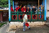 Monks share a light moment during their break at the Ramtanka Temple in Paro, Bhutan. Photo: Sanjit Das/Panos