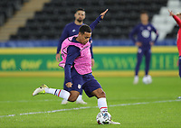 SWANSEA, WALES - NOVEMBER 12: Tyler Adams #4 of the United States warming up before a game between Wales and USMNT at Liberty Stadium on November 12, 2020 in Swansea, Wales.