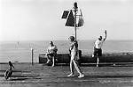 Santa Barbara California . At the end of the pier a man does his morning exercises. 2001