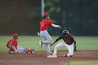 AZL Angels shortstop Jeremiah Jackson (8) turns a double play over the head of Alexander Canario (14) as Jose Verrier (4) looks on during an Arizona League game against the AZL Giants Black at the San Francisco Giants Baseball Complex on July 1, 2018 in Scottsdale, Arizona. AZL Giants Black defeated the AZL Angels 4-2. (Zachary Lucy/Four Seam Images)