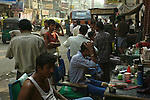 Street barbers in the Paharganj district of New Delhi, India.